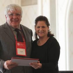 Richard Moore receiving award