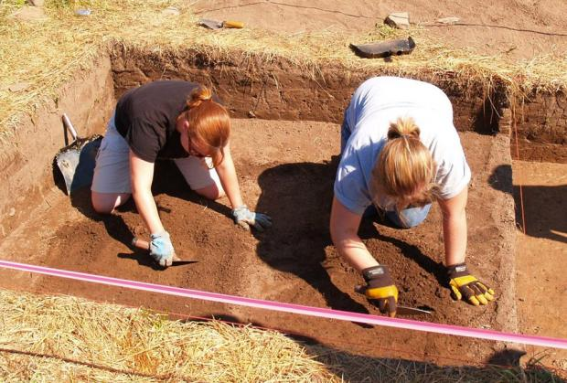 Lori Tremblay excavating in an historic cemetery