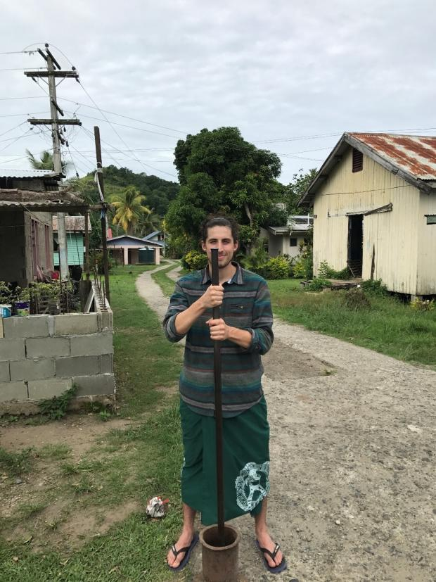 Kyle Riordan pounds kava in Fiji