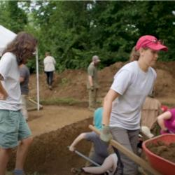 Archaeologists working a dig
