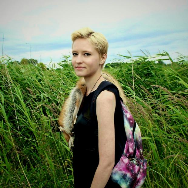Image of Emma Brzezinski standing in a field of tall grass