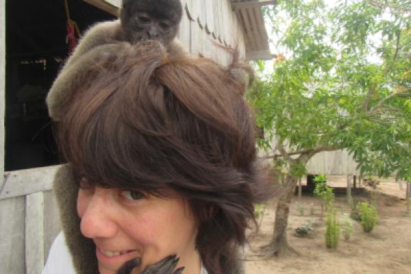 Woolly monkey sitting on Dr. Piperata's head