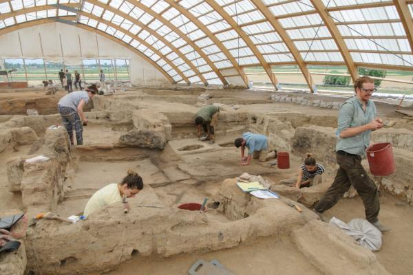 This image shows archaeologists working on an archaeological excavation at Çatalhöyük