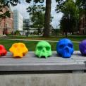 3d printed skulls in many colors