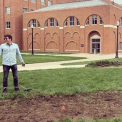 Dr. Kawa stands in front of biosolids on the university campus
